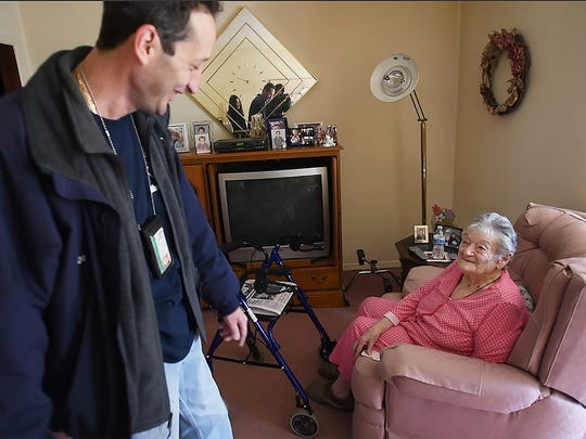 Joseph Wall, a Meals On Wheels driver for 26 years, chats with senior Mary-Ann Bino of Totowa after delivering a meal, photographed on March 22, 2017.
