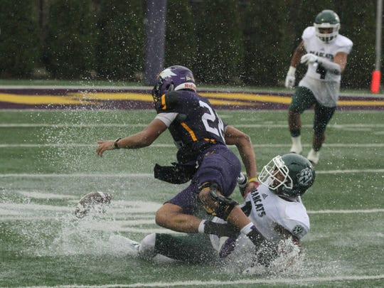 The ninth-ranked Ashland University Eagles survived a soggy showdown with two-time defending national champion Northwest Missouri State to advance to the second round of the NCAA Division II playoffs.