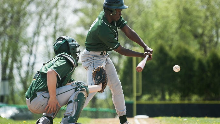 Winooski's Abdul Arbow (9) hits the ball during the high school baseball game between Peoples and Winooski on May 14.