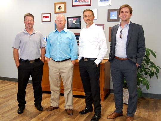 Insurance Services United partnered with Royal Square Development and Construction to purchase, rehabilitate and open its new downtown York office. Pictured, from left, are: Tad Shirey, principal, Insurance Services United; Judd Lando, principal, Insurance Services United; Josh Hankey, partner, Royal Square Development and Construction; and Dylan Bauer, partner, Royal Square Development and Construction.