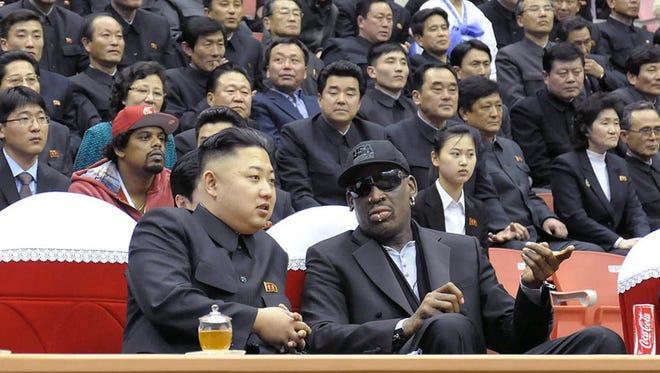 North Korean leader Kim Jong Un and  former NBA star Dennis Rodman watch a basketball game in Pyongyang in February.