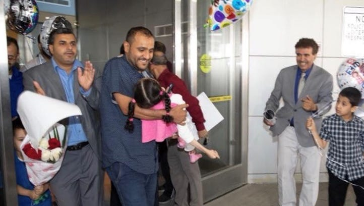 Nageeb Alomari carries his 11-year-old daughter Shaema