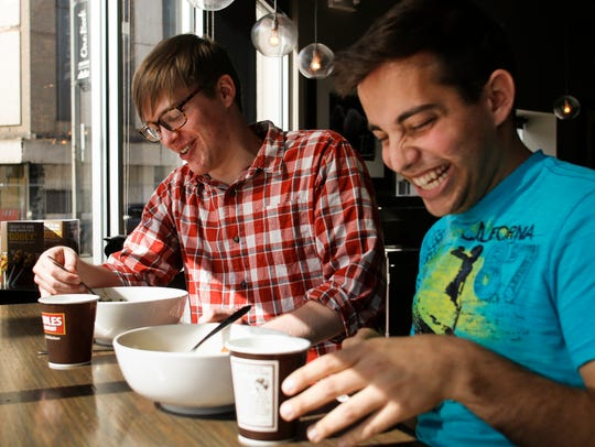 Brandon Mistry, 24, right, of Grand Ledge has lunch