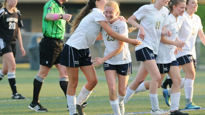 Sarah Lewis is congratulated after scoring the first goal for the Roberson girls soccer team on Monday night in Skyland.