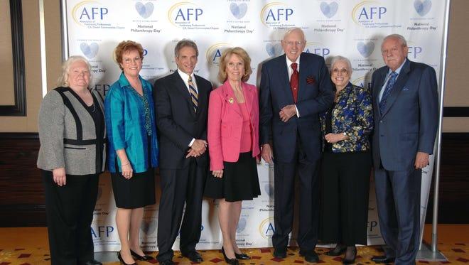 (left to right) Six National Philanthropy Day Honorees - Christy Porter, Sarah G. Clapp, Bruce Landgarten, Diane Rinker, Harry S. Rinker, Sandy Cooper Woodson, and R.D. Hubbard