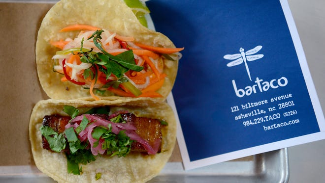 """Bartaco's pork belly taco with topped with a spicy arbol chili sauce and the shrimp """"banh mi"""" is topped with sriracha tofu sauce and pickled vegetables."""