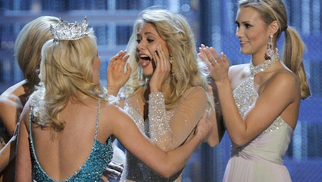 Miss Michigan Kirsten Haglund, center, reacts as she is named Miss America 2008 during the Miss America Pageant at the Planet Hollywood hotel and casino in Las Vegas, Saturday, Jan. 26, 2008.