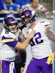 FILE - In this Dec. 23, 2018, file photo, Minnesota Vikings quarterback Kirk Cousins (8) pats tight end Kyle Rudolph (82) after Rudolph scored a touchdown during the second half of an NFL football game against the Detroit Lions, in Detroit.  In his ninth season with the Minnesota Vikings, tight end Kyle Rudolph realizes he doesn't have many more of these chances to win a championship. The Vikings start the playoffs at New Orleans on Sunday, Jan. 5, 2020. (AP Photo/Rey Del Rio, File)