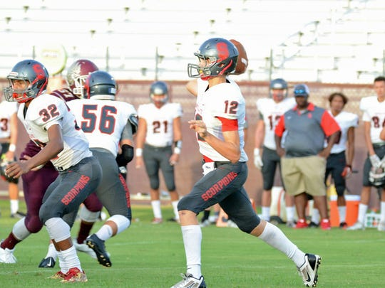 Satellite quarterback Noah Mumme drops back to complete his first pass in an away game against the Astronaut War Eagles in Titusville.