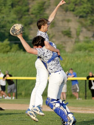 Horseheads pitcher Trey Princiotto celebrates with catcher Andrew Thompson after the Blue Raiders captured the Section 4 Class AA baseball title May 23 with a 14-0 win over Corning at Corning-Painted Post High School.