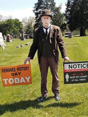 Kevin Skoglund, attired as one of Kewanee's residents from the past, installs signs in the Old Kewanee Cemetery at the corner of First and East streets in preparation for Kewanee History Day, Saturday, June 13.