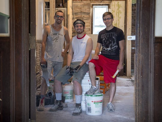 From left, Max Nussenbaum, 24 Tim Dingman, 24 and Scott Lowe, 24 all of Detroit stand in the Virginia Park house they are rehabbing, Thursday, August 7,  2014.   They are three of four fellows in the Venture for America program and their venture is called Rebirth Realty.