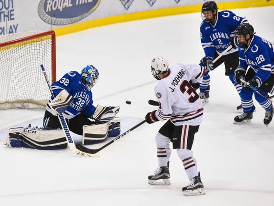 A shot is deflected by University of Alabama-Huntsville