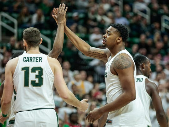 Michigan State's Nick Ward (44) high-fives teammates after scoring during the second half of MSU's 93-71 win over Stony Brook on Sunday, Nov. 19, 2017, at Breslin Center.