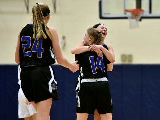 Kennard-Dale players greet each other after winning a YAIAA girls' basketball game Friday, Jan. 26, 2018, at Eastern York. Kennard-Dale defeated Eastern York 53-42 in double overtime.