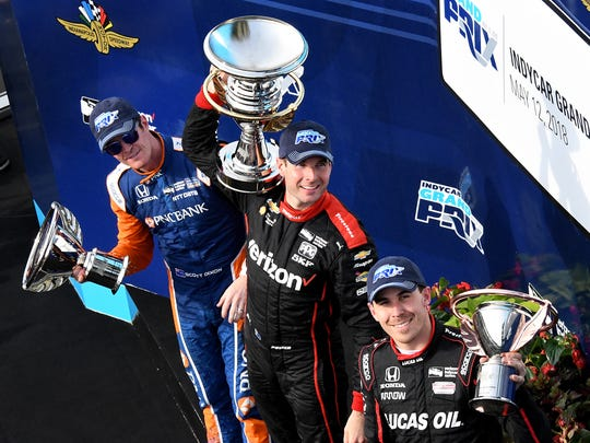 Team Penske IndyCar driver Will Power (12) ,middle, celebrates winning the IndyCar Grand Prix with 2nd place finisher Scott Dixon,left, and 3rd place finisher Robert Wickens (6),right, at the Indianapolis Motor Speedway on Saturday, May 12, 2018.