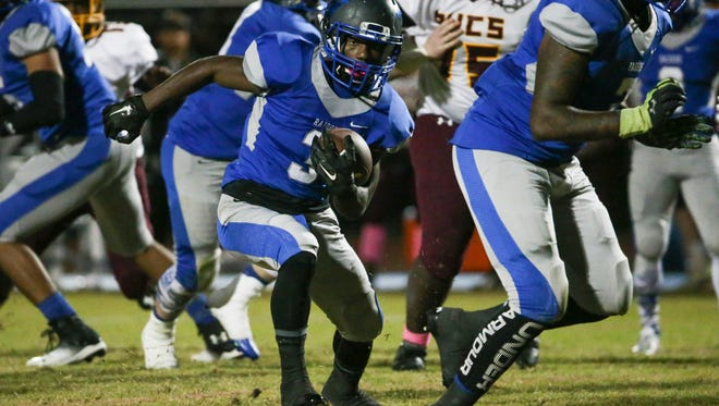 Antwain Holden of Woodbridge runs against Milford on Oct. 28. The Blue Raiders have been ranked No. 1 in Division II by The News Journal all season, and will open the playoffs at home against Howard on Friday night.