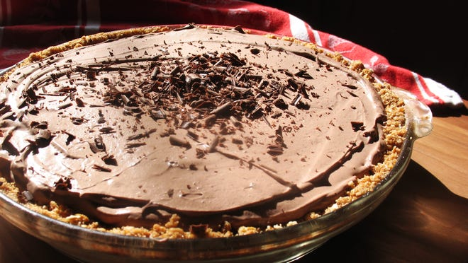 No-bake peanut butter pie is sandwiched between a pretzel crust and chocolate whipped cream - oh, my!