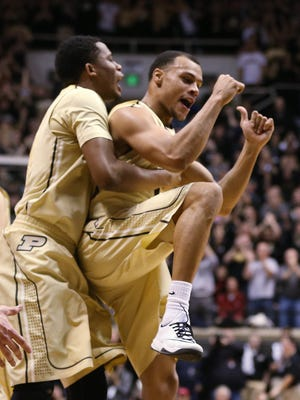 Purdue Boilermakers forward Basil Smotherman and teammate Bryson Scott celebrate Purdue's double digit lead over Indiana in the first half. Purdue hosted Indiana at Mackey Arena Wednesday, January 28, 2015.