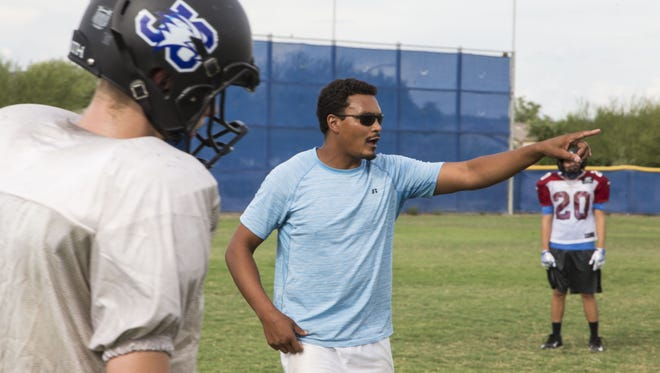 New coach Micah Johnson of Joy Christian High School talks to his team during the practice.