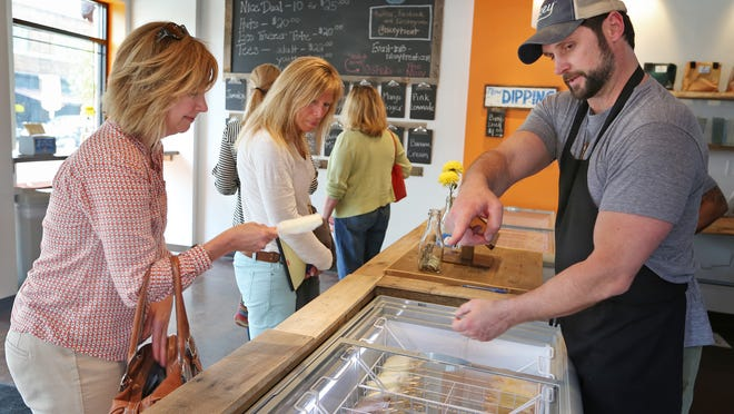 Nicey Treat owner Jeff Patrick helps Nancy Wise (left) and Renda Lains choose a flavor at the company's store in Broad Ripple.