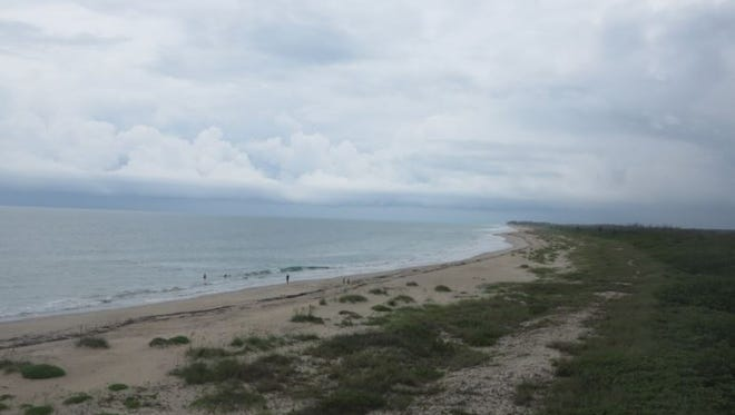 Conditions are favorable for afternoon thunderstorms with frequent lightning and gusty winds. This photo was captured at noon by a web cam at the Hobe Sound Wildlife Refuge.