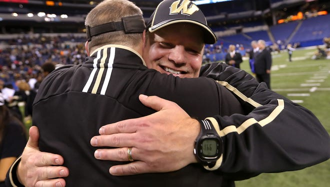 Warren Central head coach Jayson West is all smiles while being congratulated on his teams win over Carmel in the IHSAA Class 6A State Football Finals held at Lucas Oil Stadium on Saturday, November 30, 2013. Warren Central beat Carmel 7-6.