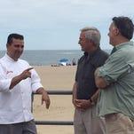 """Cake Boss"" star Buddy Valastro unveils a sandcastle cake on the Asbury Park boardwalk Thursday."
