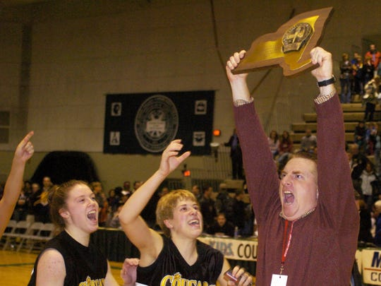 Honeoye Falls-Lima  coach Steve Willoughby holds the 2005 Class A  state championship trophy up for the crowd with players Maddy Brown and Jessica Chapin, from left, after beating Burnt Hills-Ballston Lake.