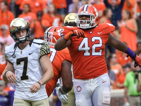 Clemson defensive tackle Christian Wilkins (42) reacts after Wake Forest kicker Mike Weaver (7) misses a field goal during the third quarter in Memorial Stadium at Clemson on Saturday.