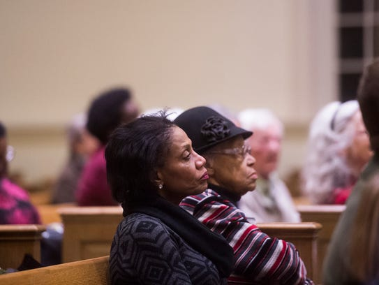 Members of the audience listen to a speaker during