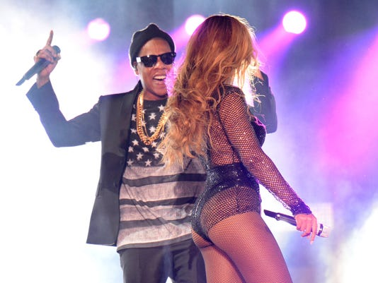beyonce and jay z tour drunken fan charged after rushing stage