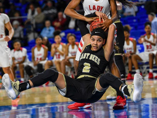 East Nashville High School Quentarra Mitchell (32) spins Upperman High School Akira Levy (2) around as they fight for the ball in the TSSAA Basketball Girls State Championship at the Murphy Center in Murfreesboro, Tenn., Thursday, March 8, 2018.