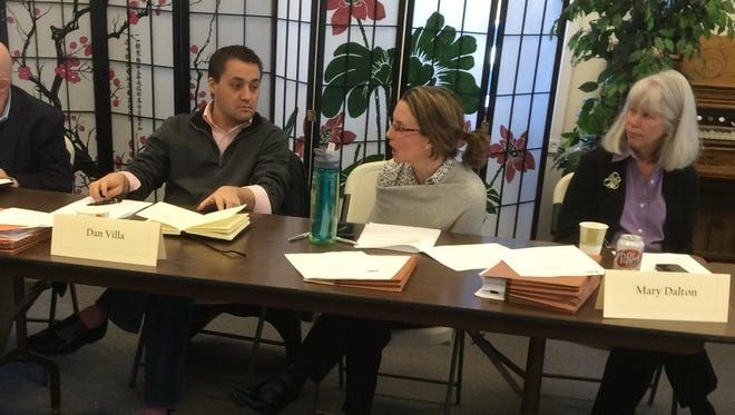 State Budget Director Dan Villa, left, talks Thursday with Rebecca de Camara of the Department of Public Health and Human Services as Mary Dalton of the DPHHS looks on during the meeting of the Montana Developmental Center Transition Planning Advisory Council.