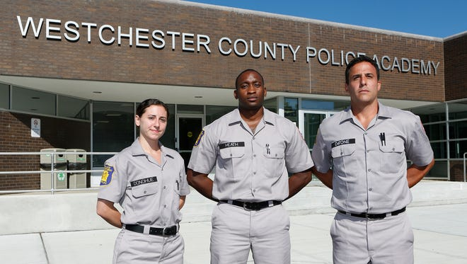 Yonkers police cadets Theresa Donohue, left, Michael Heath and John DeTone at the Westchester County Police Academy in Valhalla on Thursday.