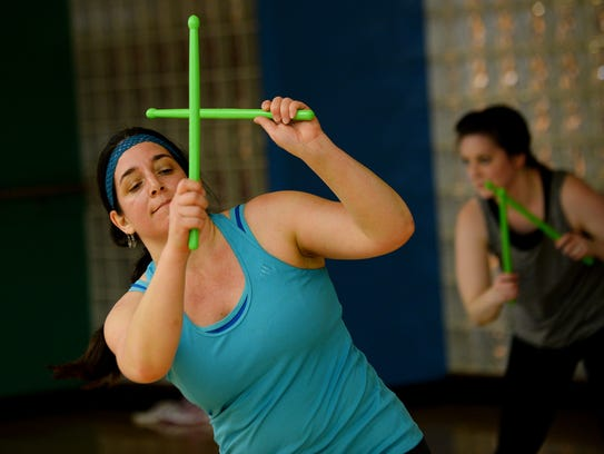 Julianne Daher works out in the Pound class on Wednesday,