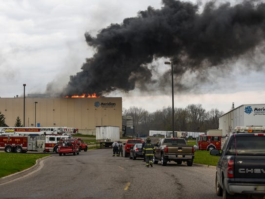 Firefighters wait for magnesium to burn out at a fire