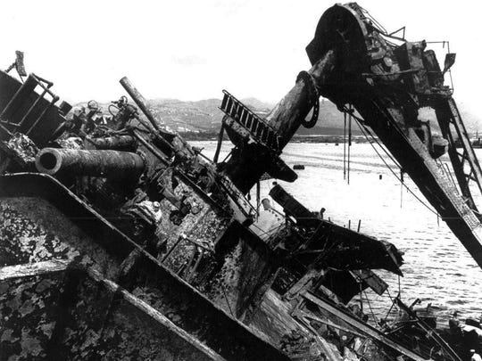 The capsized battleship USS Oklahoma is lifted out of the water at Pearl Harbor in Honolulu, Hawaii in 1943. The Oklahoma was hit by at least nine torpedoes at Pearl Harbor. A total of 429 men on the ship lost their lives.