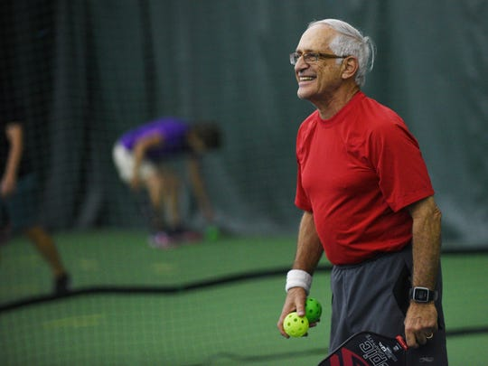 Norm Levy, a longtime tennis player, has been playing pickleball this summer with a brace on his knee. He's 75, he says, and never completely recovered from a tornmeniscus.