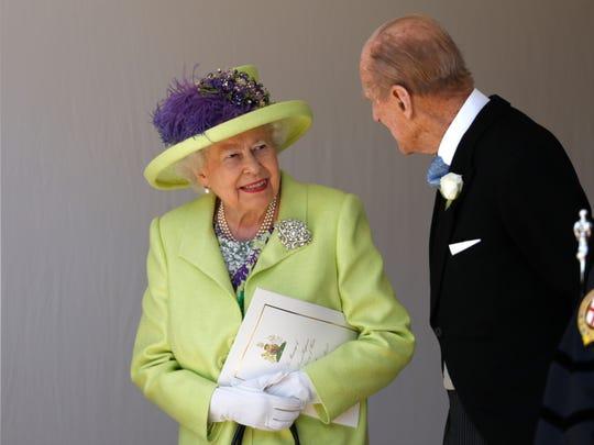 Queen Elizabeth II talks with Prince Philip, Duke of