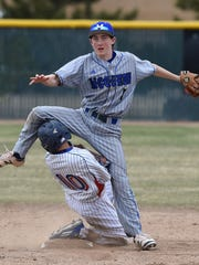 McQueen's Austin Parry watches his throw to first base for the double play as Reno Garret Damico runs into him in the 2017 Mike Bearman Memorial on Friday.