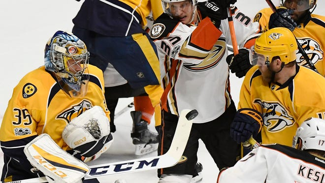 All eyes were on the puck as Nashville Predators goalie Pekka Rinne (35) makes a stop during the first period of game four of the Western Conference finals at Bridgestone Arena Thursday, May 18, 2017 in Nashville, Tenn.