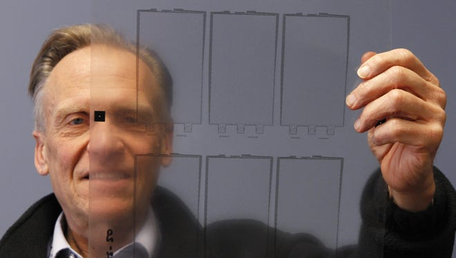 William Pollock, President and CEO of Kingsbury Corp. on Lexington Ave. in Rochester, looks over a finished sheet of touchscreens produced at his company Wednesday, April 9, 2014.