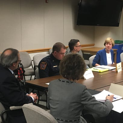 US Sen. Tammy Baldwin talks with Green Bay officials