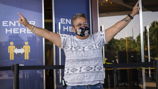 "A Mount Prospect woman who identified herself as ""Sunshine"" celebrates as she enters Rivers Casino Wednesday in Des Plaines on the first day of reopening following an unprecedented three-month shutdown due to the coronavirus pandemic."