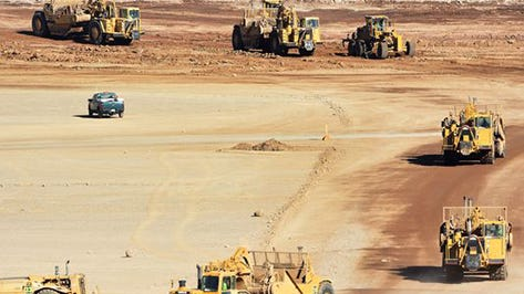 Construction workers operate heavy equipment in this RGJ file photo of the gigafactory site.