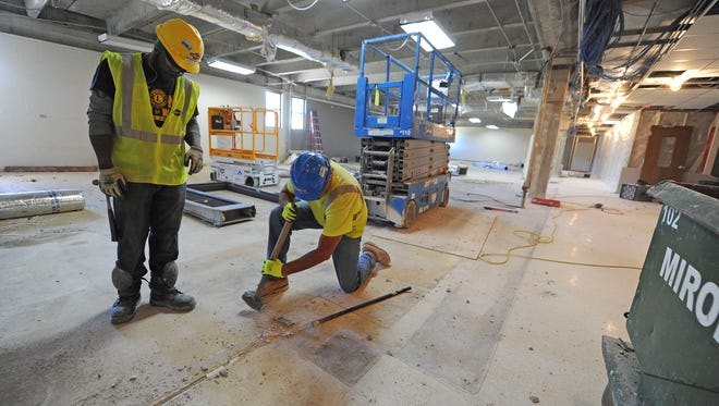 Workers for Miron Construction demolish interior spaces Monday at NWTC in part of the college's Business and Information Technology building. It's an $8 million project that's one of the first to start using funds voters approved in an April 2015 referendum. The project will add 21,000 square feet of new space and revamp another 46,000 square feet, giving the department more space to continue adding programs and students.
