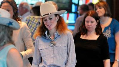 Kim McConville of Red Hook kicks up a heel at Astor Services for Children & Families' Roundup Line Dancing Event on Saturday in Rhinebeck.