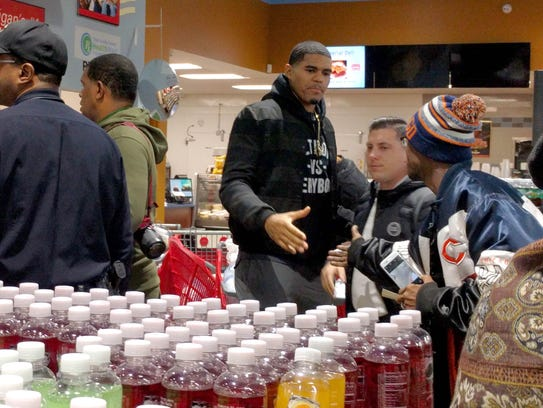 Pistons forward Tobias Harris greets store customers