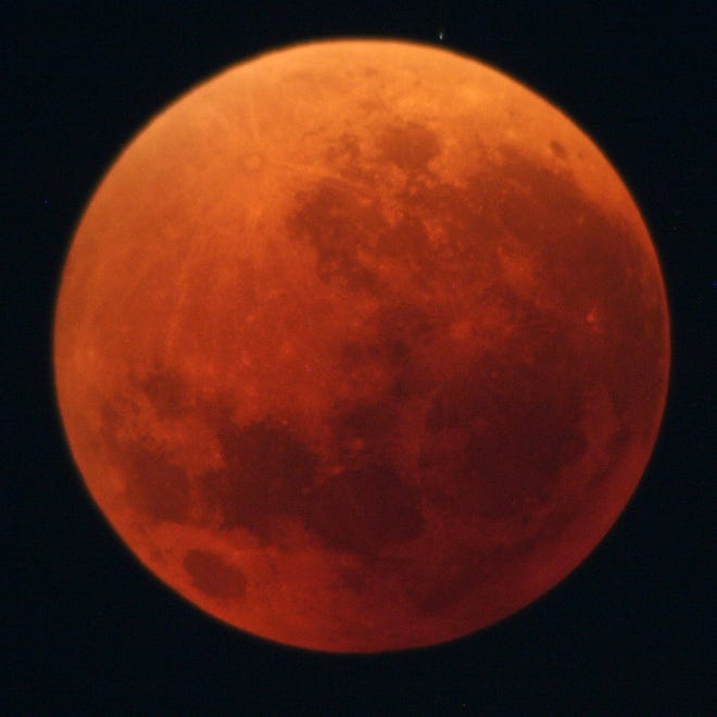 A total lunar eclipse, with the moon appearing red in color, is seen in Japan on Aug. 28, 2007.